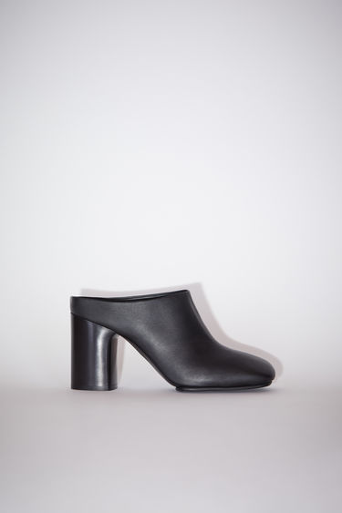 Acne Studios black mules are crafted from soft lamb leather to a square-toe shape and set on a high block heel and durable rubber sole.