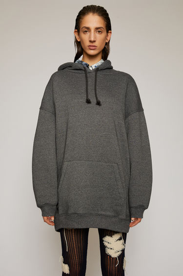 Acne Studios black hooded sweatshirt is crafted for an oversized fit from midweight loopback jersey and adorned with a label patch that's left with loose thread for a subtle note of texture.
