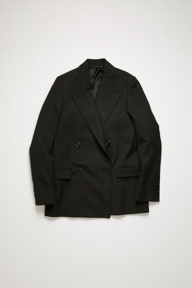 Acne Studios black wool-blend suit jacket is crafted to a double-breasted silhouette and finished with wide notch lapels and two front flap pockets.