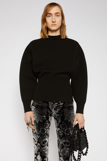 Acne Studios black sweater is knitted with voluminous dolman sleeves and features exaggereated ribbing on the fitted cuffs and hem to define the waistline.