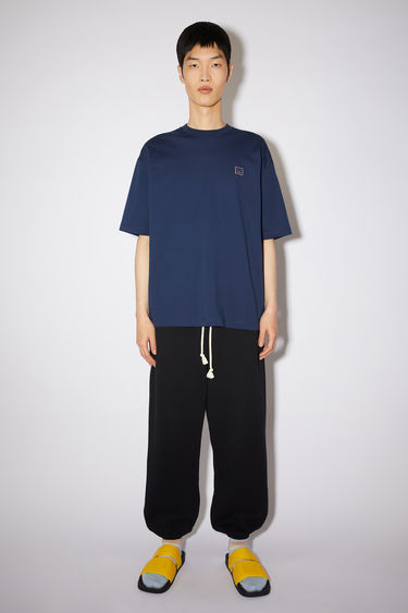 Acne Studios navy cotton jersey t-shirt features a rhinestone face at the chest and diamond print on the back.