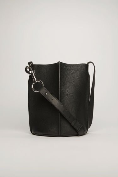 Acne Studios black bucket bag is crafted from soft grained leather with a logo-debossed leather lining and features an adjustable shoulder strap and a detachable zip wallet.