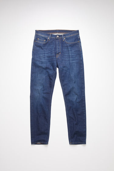 Acne Studios River Dark Blue jeans are crafted from comfort stretch denim that's faded and whiskered to give a worn-in appeal. They're shaped to sit high on a waistband before falling to a slim, tapered leg.