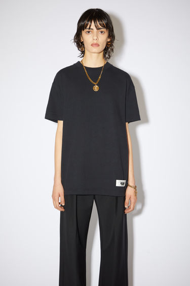 Acne Studios black crew neck t-shirt is made of organic cotton with an Acne Studios label on the lower front.