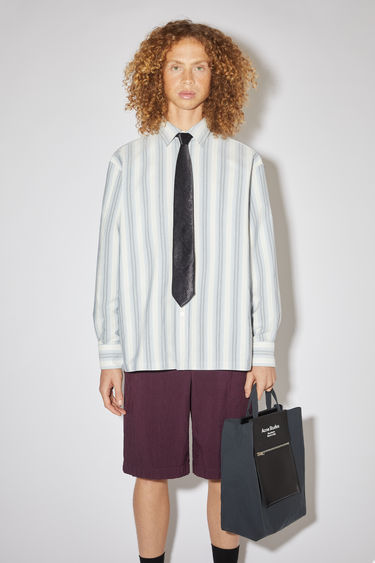 Acne Studios cold grey/white casual, long sleeve shirt features a boxy fit in a lurex stripe.
