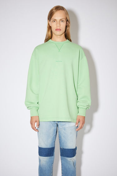 Acne Studios mint green oversized sweatshirt is made of cotton and features an Acne Studios logo on the front.