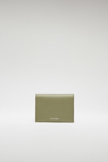 Acne Studios dark green/black bifold cardholder is crafted from smooth leather and features four card slots and a silver stamped logo on the front.