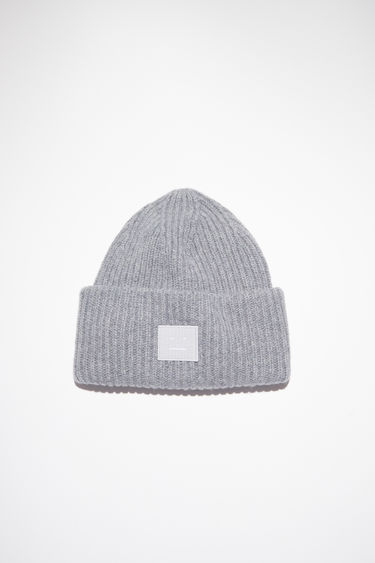 Acne Studios grey melange beanie is knitted in a thick rib-stitch from soft wool and features a tonal face-embroidered patch on the turn-up.