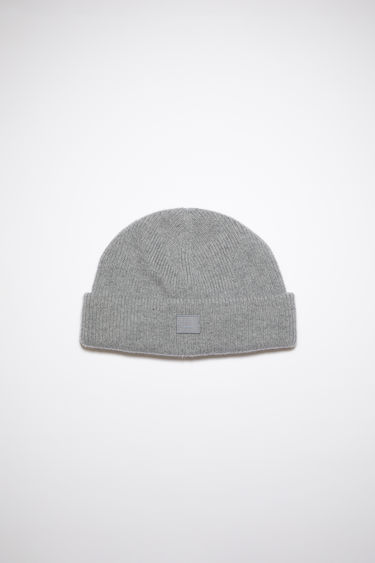 Acne Studios grey melange beanie is knitted with wool and lycra for a closer fit and accented with a small tonal face-embroidered patch on the turn-up.