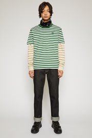 Acne Studios deep green t-shirt is cut from lightweight cotton jersey that's patterned with breton stripes and features a tonal face-embroidered patch on the chest.
