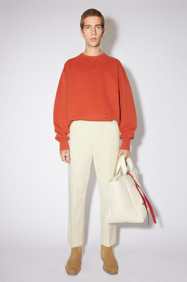 Acne Studios champagne beige casual trousers are made of cotton with an elasticised drawstring waist.
