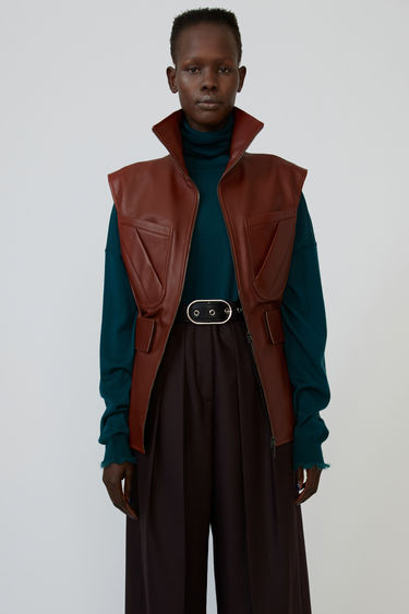 Acne Studios cardinal brown zip-up gilet is crafted from lamb leather to a flared silhouette and shaped with an elasticated waist.