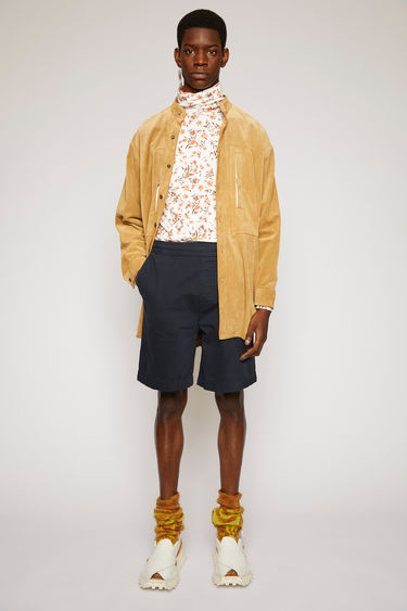 Acne Studios dark blue shorts are cut from a soft cotton twill with a high-rise waist and straight legs and finished with an elasticated waistband.