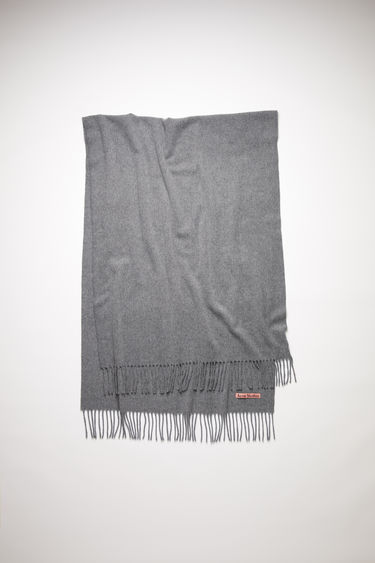 Acne Studios Canada New grey melange scarf is crafted from pure wool to a wide dimension with fringed edges and set with a label in one corner.