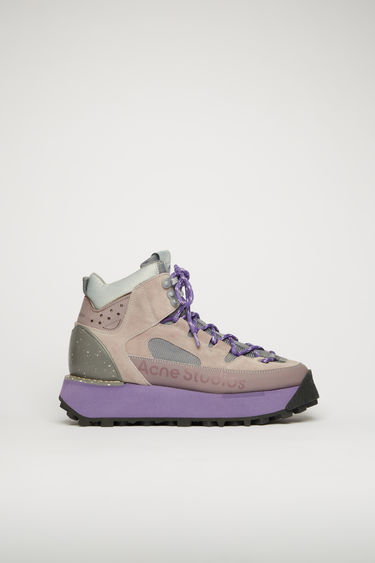 Acne Studios dusty purple boots take cues from functional elements of hiking gears. They're crafted with faux suede and mesh overlays, fastened with rope-style laces and metal lace clasps and set on a lug sole.