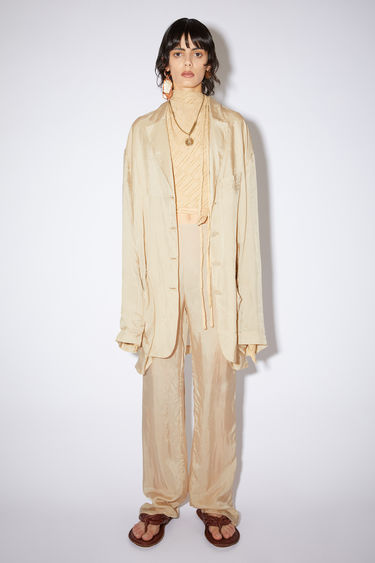 Acne Studios ecru beige oversized, single-breasted suit jacket is made of cupro.