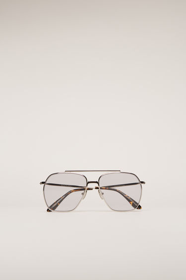 Acne Studios Anteom silver/grey sunglasses are shaped with squared aviator frames and set with grey-tinted lenses and acetate arm tips.