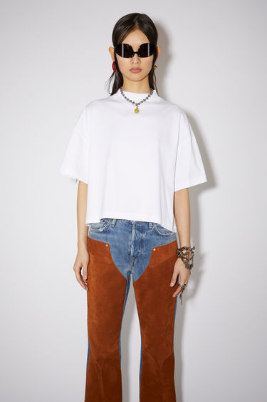 Acne Studios optic white t-shirt is made from organically grown cotton and cut to a boxy silhouette with a high neckline and wide, short sleeves.