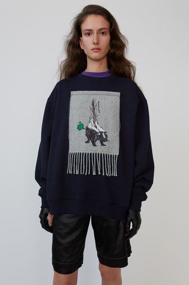Acne Studios navy blue oversized sweatshirt with embroidered animal scarf applied on the chest.