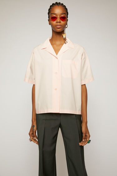 Acne Studios pastel pink bowling shirt is crafted from lightweight cotton poplin with a patch pocket on the chest.
