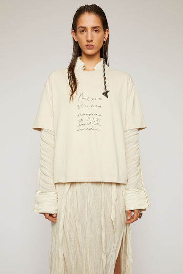 Acne Studios melange white t-shirt is cut to a boxy silhouette from cotton jersey and features a handwritten logo and headquarter's address embroidered on the front.