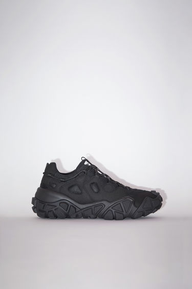 Acne Studios black/black lace-up sneakers are made of a suede-like fabric.