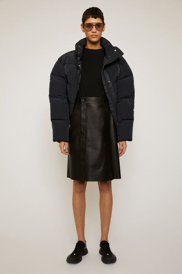 Acne Studios black pencil skirt is crafted from soft, lamb leather and features an off-centered fly and slit at front.