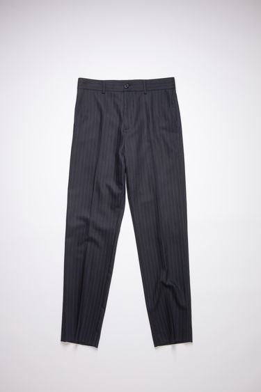 Acne Studios navy/white pinstripe trousers are made of a wool blend with a subtle stretch and a casual fit.