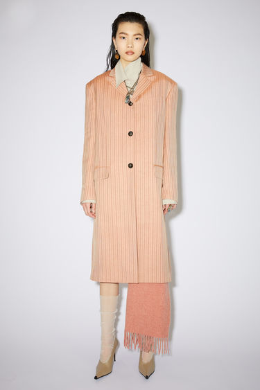 Acne Studios pink/brown single-breasted striped coat is made of a linen blend with a relaxed fit.