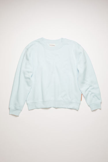 Acne Studios ice blue sweatshirt is cut from brushed cotton jersey with ribbed trims and has a pink logo-jacquard tab sewn on the side seam.