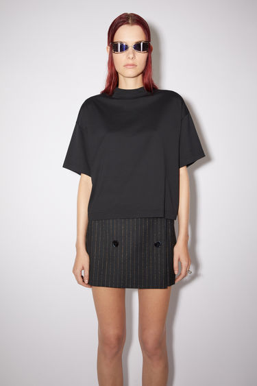 Acne Studios black t-shirt is made from organically grown cotton and cut to a boxy silhouette with a high neckline and wide, short sleeves.