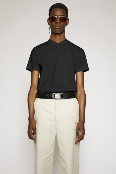 Acne Studios black t-shirt is crafted to a slim fit from soft cotton jersey and shaped with a V-neckline and short sleeves.