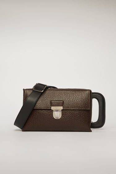 Acne Studios chocolate brown satchel is crafted to a boxy silhouette from grain leather and has a silver-tone branded hardware and an iridescent tape on the side panel.