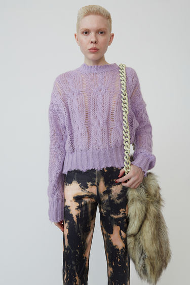 Acne Studios lilac purple sweater is loosely knitted in cable-knit pattern and finished with frayed trims.