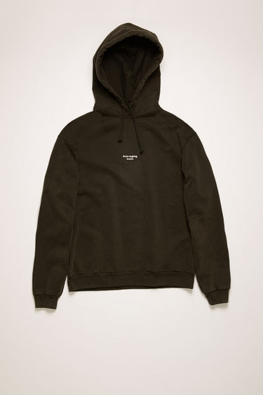 Acne Studios black hooded sweatshirt is made from cotton jersey that's been garment dyed for a soft, washed-out finish. It's shaped for an oversized fit and features a reversed logo purposely printed imprecisely across the front.
