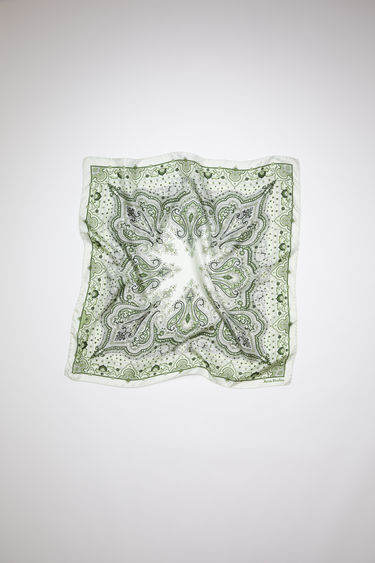Acne Studios green square bandana scarf is made of silk, featuring a modified paisley print.
