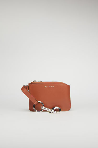 Acne Studios almond brown pouch is crafted from smooth leather and fitted with a lobster clasp that can be attached to bags and belt loops.