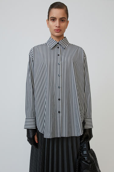 Acne Studios black/white shirt is crafted to an oversized fit and printed with a stripe pattern.
