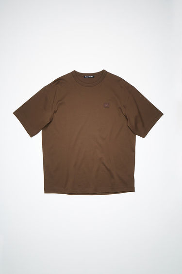 Acne Studios chestnut brown organic cotton t-shirt features an embroidered face patch on the chest.
