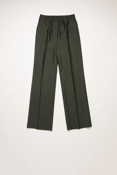 Acne Studios green trousers are crafted from wool-blend suiting and shaped to a straight-leg fit with an elastic waistband.