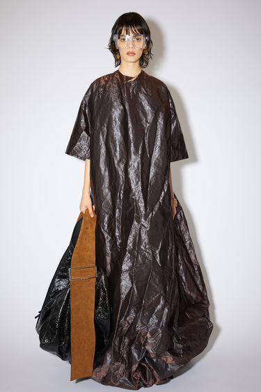 Acne Studios chestnut brown voluminous evening dress is made of textured polyester with a sheen.