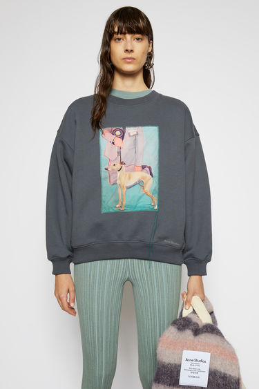 Acne Studios slate grey sweatshirt is crafted from organic cotton to a relaxed silhouette with dropped shoulders and adorned with a printed patch, featuring a prize dog created by Britsh artist Lydia Blakeley.