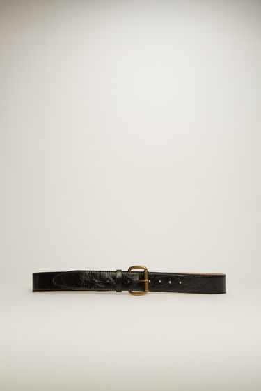Acne Studios black belt is crafted to a wide dimension from high-shine cracked leather and features an antiqued gold-tone buckle.