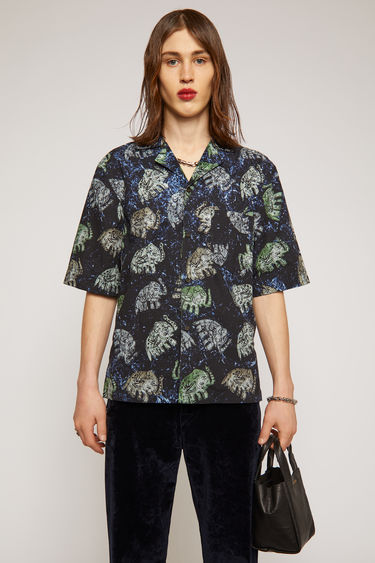Acne Studio navy short-sleeved shirt is made from lightweight cotton patterned with elephant motifs. It's cut for boxy fit and has an open collar and a chest patch pocket.