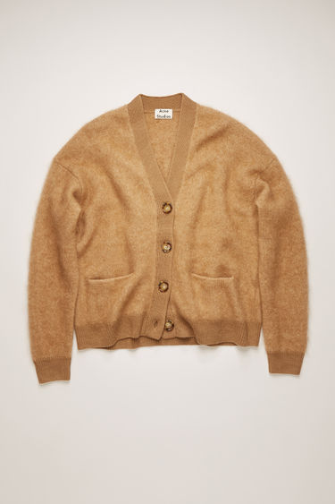 Acne Studios Rives Mohair caramel brown cardigan is shaped to a loose silhouette with dropped shoulders and finished with ribbed trims.