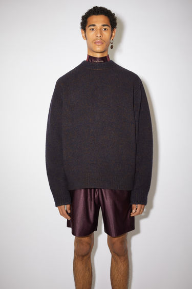 Acne Studios navy/brown sweater is knitted from soft wool and cashmere-blend yarn to a relaxed silhouette and framed with thick, ribbed edges.