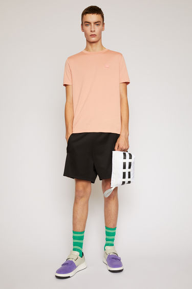 Acne Studios pale pink t-shirt is cut to a slim silhouette in lightweight cotton jersey and finished with a tonal face-embroidered patch on the chest.