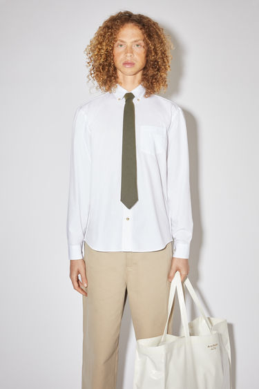 Acne Studios optic white long sleeve shirt is made of cotton with a classic fit.