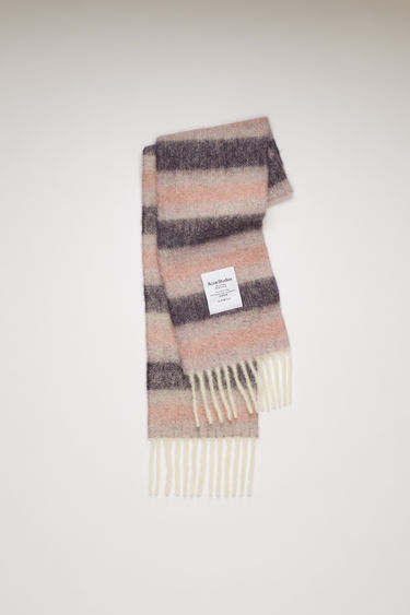 Acne Studios purple/lilac/pink striped scarf is spun from a blend of alpaca, wool and mohair yarns in a relaxed long-length silhouette that drapes through the body. It's finished with a soft, brushed texture and a logo patch above the fringed edges.