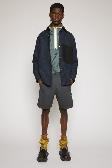 Acne Studios slate grey shorts are made from brushed cotton jersey with a washed out finish and features an elasticated drawstring waist and a reversed logo print.
